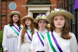 Four suffragettes outside the Centre